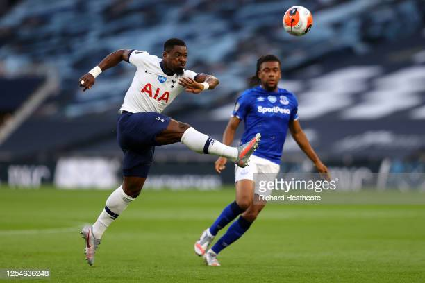 Serge Aurier of Tottenham Hotspur clears the ball from Alex Iwobi of Everton during the Premier League match between Tottenham Hotspur and Everton FC...