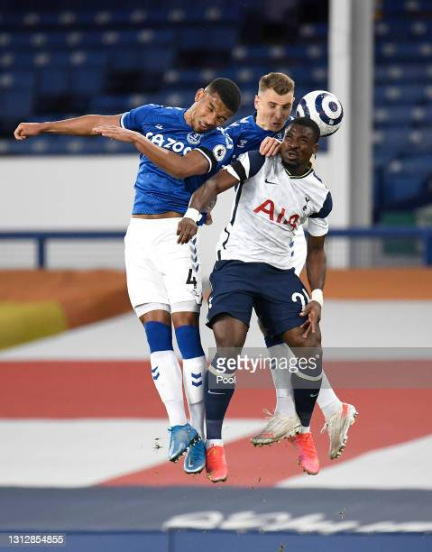 Serge Aurier of Tottenham Hotspur competes for a header with Mason Holgate and Lucas Digne of Everton during the Premier League match between Everton...