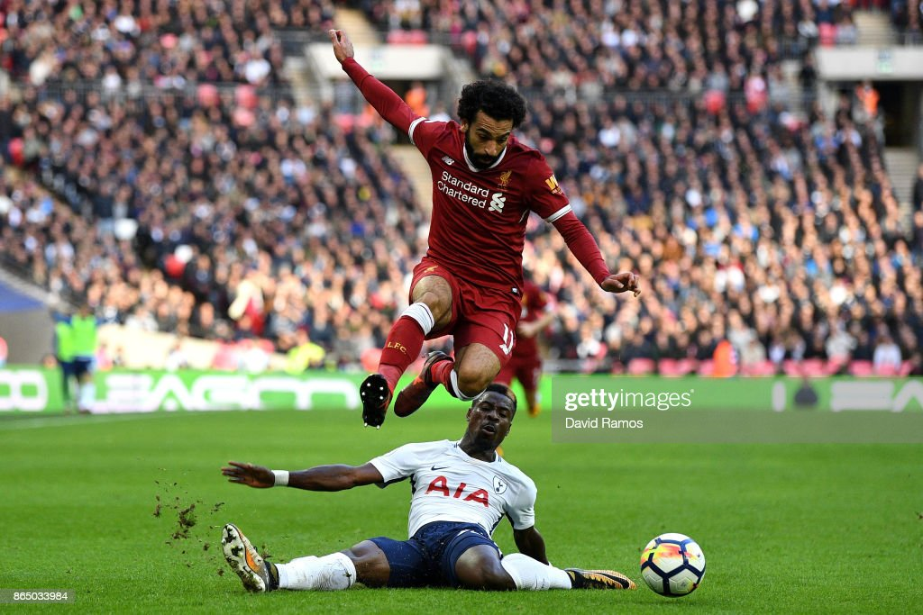 Serge Aurier of Tottenham Hotspur fouls Mohamed Salah of Liverpool during the Premier League match between Tottenham Hotspur and Liverpool at Wembley Stadium on October 22, 2017 in London, England.
