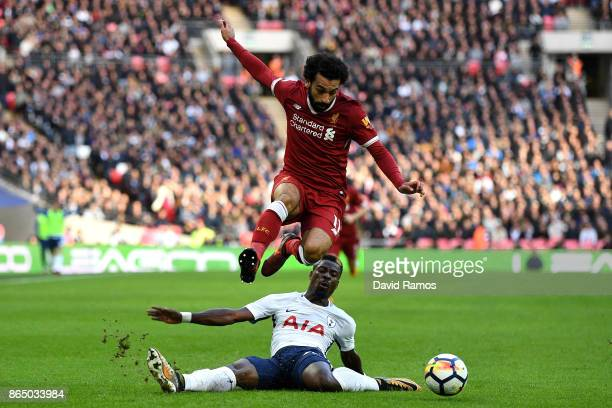 Serge Aurier of Tottenham Hotspur fouls Mohamed Salah of Liverpool during the Premier League match between Tottenham Hotspur and Liverpool at Wembley...