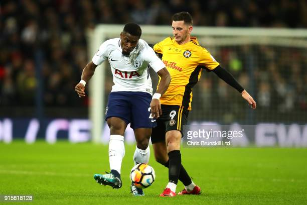 Serge Aurier of Tottenham Hotspur in action with Padraig Amond of Newport County during the Emirates FA Cup Fourth Round Replay between Tottenham...