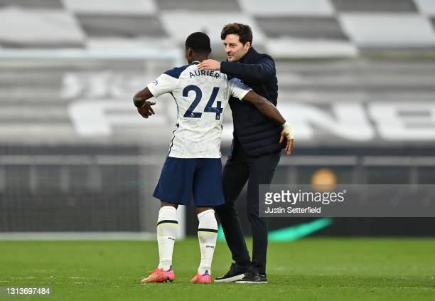 Serge Aurier of Tottenham Hotspur interacts with Ryan Mason, Interim Manager of Tottenham Hotspur after the Premier League match between Tottenham...