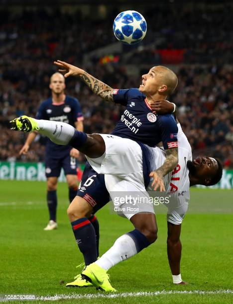 Serge Aurier of Tottenham Hotspur is challenged by Jose Tasende of PSV Eindhoven during the Group B match of the UEFA Champions League between...