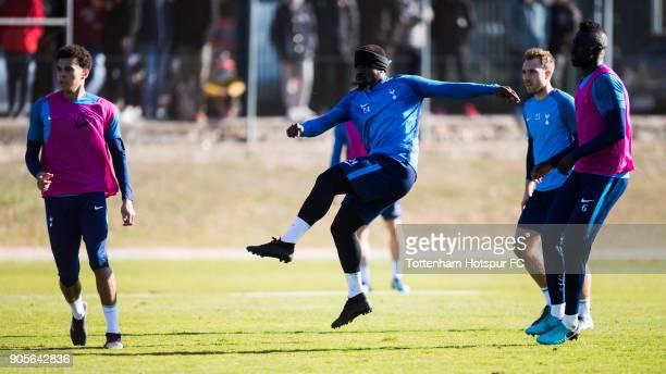 Serge Aurier of Tottenham Hotspur kicks the ball among his teammates Dele Alli Christian Eriksen and Davinson Sanchez during a training session...