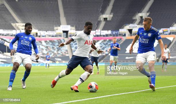 Serge Aurier of Tottenham Hotspur runs with the ball as Jamie Vardy of Leicester City looks on during the Premier League match between Tottenham...