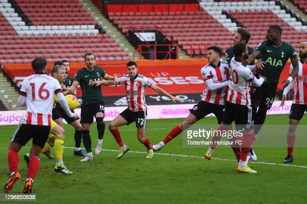 Serge Aurier of Tottenham Hotspur scores their sides first goal past Aaron Ramsdale of Sheffield United during the Premier League match between...
