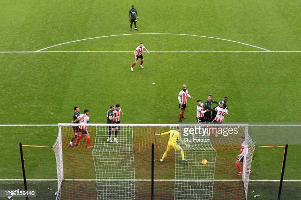 Serge Aurier of Tottenham Hotspur scores their side's first goal past Aaron Ramsdale of Sheffield United during the Premier League match between...