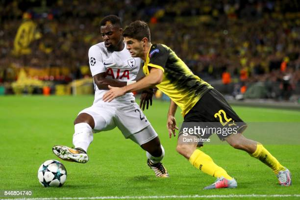 Serge Aurier of Tottenham Hotspur shields the ball from Christian Pulisic of Borussia Dortmund during the UEFA Champions League group H match between...