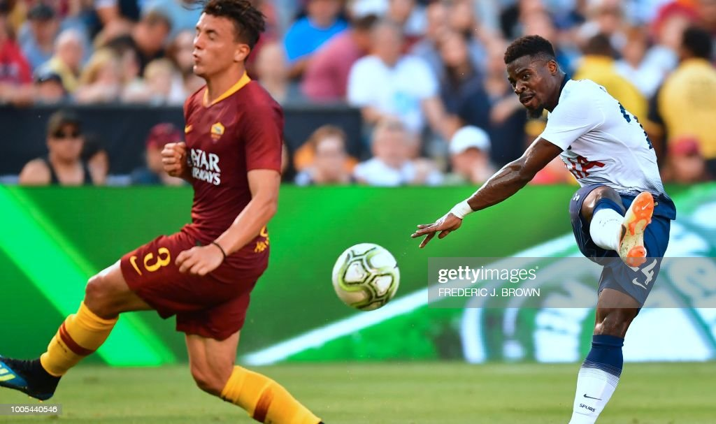 Serge Aurier (R) of Tottenham Hotspur shoots under pressure from AS Roma's Luca Pellegrini during their International Champions Cup match in San Diego, California on July 25, 2018, where Tottenham defeated Roma 4-1.
