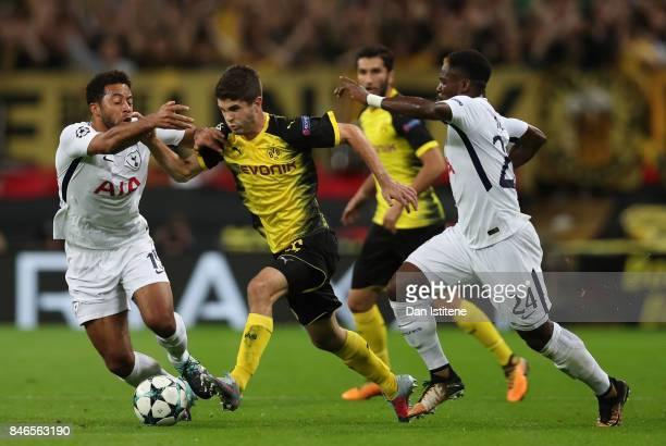 Serge Aurier of Tottenham Hotspur tackles Christian Pulisic of Borussia Dortmund during the UEFA Champions League group H match between Tottenham...