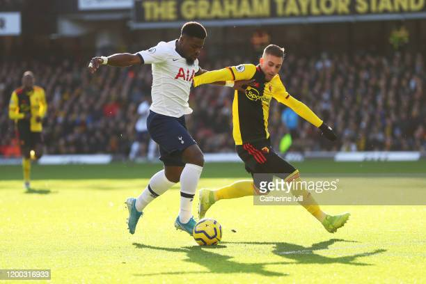 Serge Aurier of Tottenham Hotspur tackles with Gerard Deulofeu of Watford during the Premier League match between Watford FC and Tottenham Hotspur at...