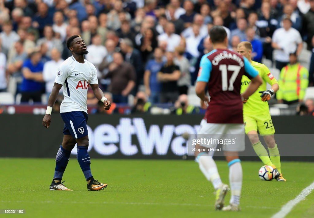 Serge Aurier of Tottenham Hotspur walks off dejected after being sent off during the Premier League match between West Ham United and Tottenham Hotspur at London Stadium on September 23, 2017 in London, England.