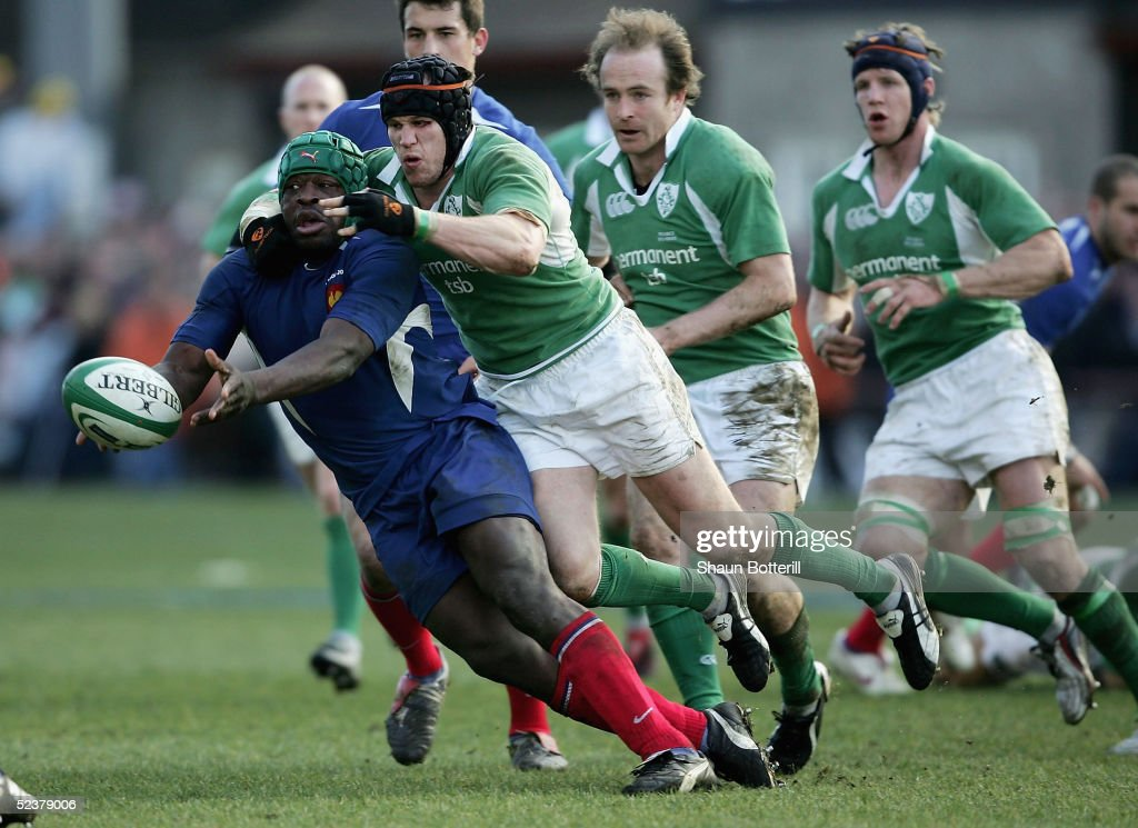 Serge Betsen of France is tackled by Jonny O'Connor during the RBS Six Nations Championship match between Ireland and France at Lansdowne Road on March 12, 2005 in Dublin, Ireland.