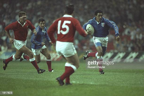 Serge Blanco of France dashes past the Welsh during the 1991 Five Nations Championship match between Wales and France at Cardiff Arms Park in Cardiff...