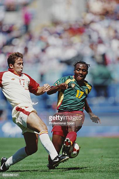 Serge Branco of Cameroon clashes for the ball with Raul Tamudo of Spain during play in the final of the Men's football tournament at the 2000 Summer...