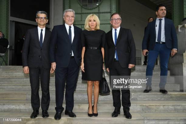 Serge Brunschwig, Sidney Toledano, Brigitte Macron and Bruno Pavlovsky pose prior the Karl Lagerfeld Homage at Grand Palais on June 20, 2019 in...