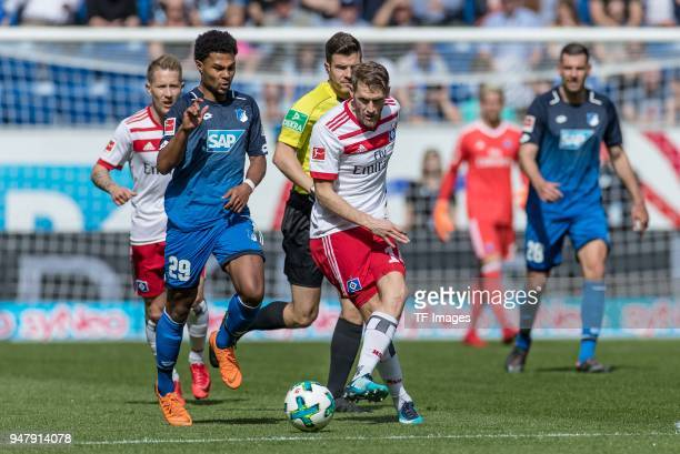 Serge David Gnabry of Hoffenheim and Aaron Hunt of Hamburg battle for the ball during the Bundesliga match between TSG 1899 Hoffenheim and Hamburger...