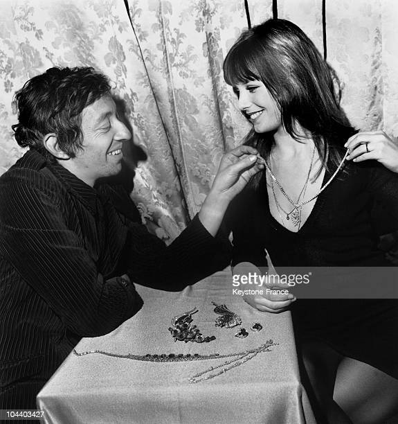Serge GAINSBOURG and Jane BIRKIN visiting the exhibtion The Most Beautiful Jewelry in the World at the great jeweller BOUCHERON's Serge GAINSBOURG...