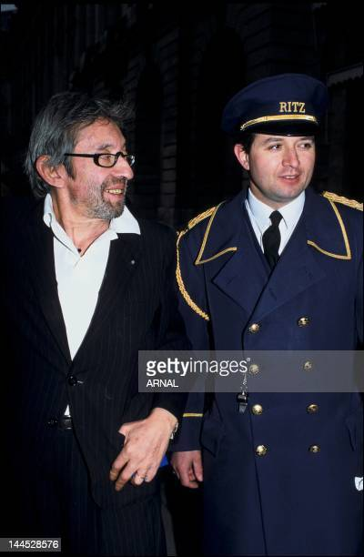 Serge Gainsbourg with a doorman of the Ritz Hotel 1991 in Paris France