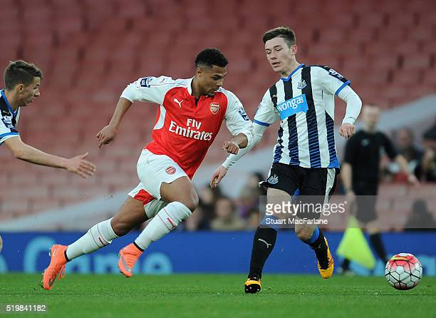Serge Ganbry of Arsenal breaks past Callum Roberts of Newcastle during the Barclays Premier League match between Arsenal and Newcastle United at...