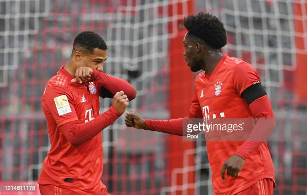 Serge Gnabry and Alphonso Davies of FC Bayern Muenchen celebrate their sides fifth goal which came through a Martin Hinteregger own goal during the...