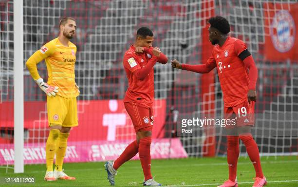 Serge Gnabry and Alphonso Davies of FC Bayern Muenchen celebrate their sides fifth goal which came through a Martin Hinteregger own goal as Kevin...