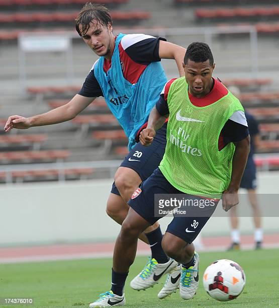 Serge Gnabry and Ignasi Miquel of Arsenal FC in Japan for the club's preseason Asian tour at the Urawa Komaba Stadium on July 25 2013 in Saitama Japan