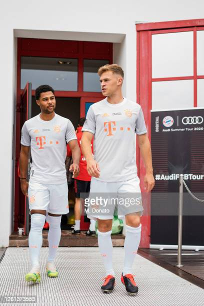 Serge Gnabry and Joshua Kimmich of FC Bayern Muenchen arrive for a training session at Saebener Strasse training ground on July 26 2020 in Munich...