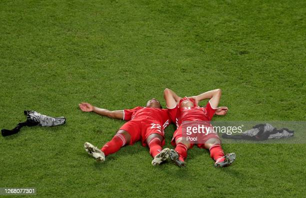 Serge Gnabry and Joshua Kimmich of FC Bayern Munich lay on the pitch in celebration following the UEFA Champions League Final match between Paris...