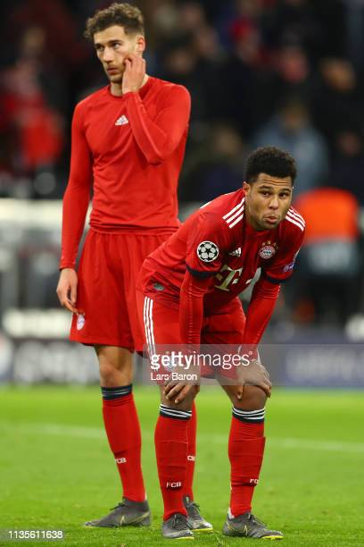Serge Gnabry and Leon Goretzka of Bayern Munich look dejected in defeat after the UEFA Champions League Round of 16 Second Leg match between FC...