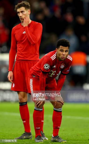 Serge Gnabry and Leon Goretzka of Muenchen looks dejeceted after loosing the UEFA Champions League Round of 16 Second Leg match between FC Bayern...