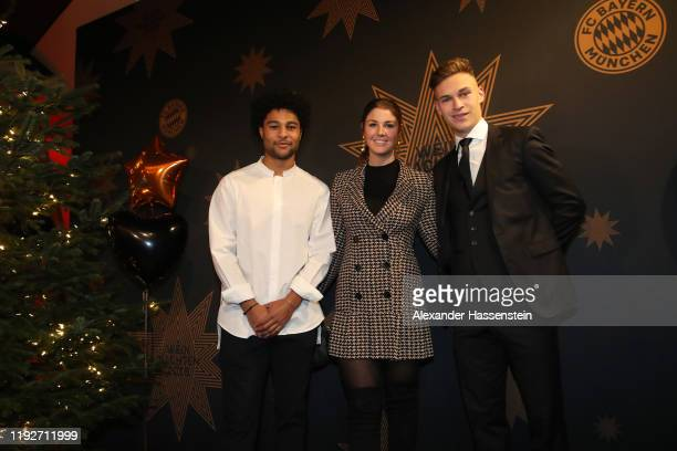 Serge Gnabry attends with team mate Joshua Kimmich of FC Bayern Muenchen and Lina Meyer the clubs Christmas party at Allianz Arena on December 08...