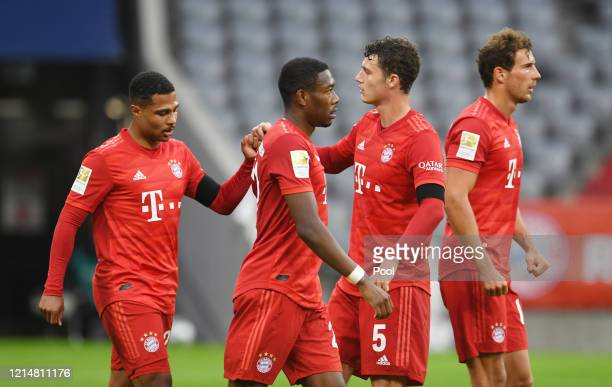 Serge Gnabry, Benjamin Pavard and Alphonso Davies of FC Bayern Muenchen celebrate their sides fifth goal which came through a Martin Hinteregger own...