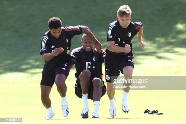 Serge Gnabry David Alaba and Joshua Kimmich of FC Bayern Muenchen during a training session at Saebener Strasse training ground on August 05 2020 in...