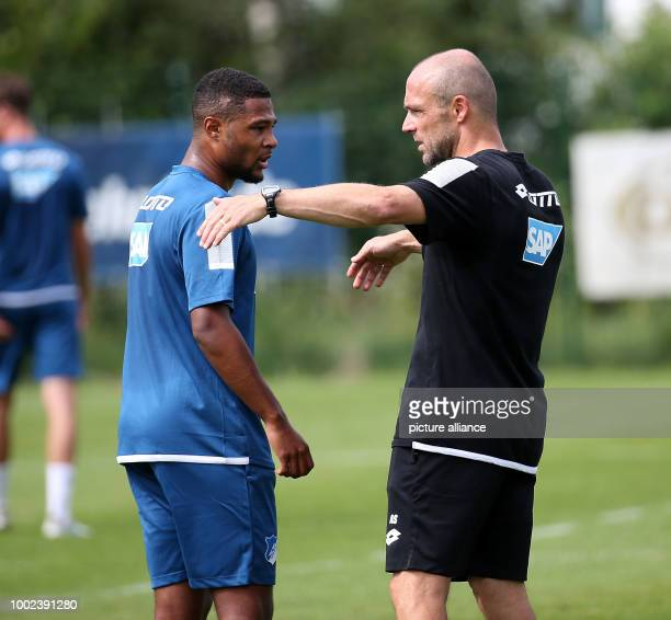 Serge Gnabry is given instructions by cocoach Alfred Schreuder at the TSG 1899 Hoffenheim training camp in Windischgarsten Austria 19 July 2017 Photo...