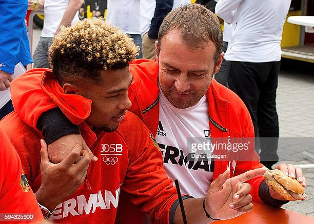 Serge Gnabry is hugged by DFB sports director HansDieter Flick during the German Men's Olympic football team welcome home reception at DFB...