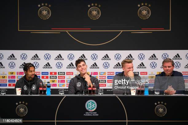 Serge Gnabry Kai Havertz Marco Reus and DFB Spokesman Jens Grittner of Germany speak at a press conference at Deutsches Fussball Museum on October 11...