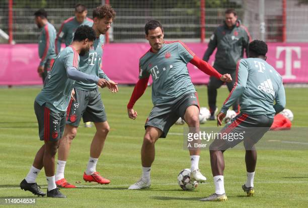 Serge Gnabry Leon Goretzka Mats Hummels and Alphonso Davies of FC Bayern Muenchen practice during a training session at the club's Saebener Strasse...