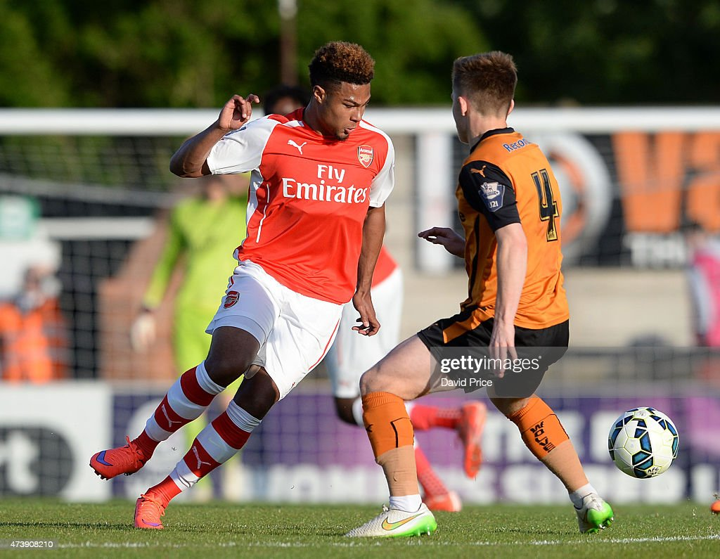 Serge Gnabry of Arsenal knocks the ball past Declan Weeks of Wolves during the match between Arsenal U21s and Wolverhampton Wanderers U21s at Meadow Park on May 18, 2015 in Borehamwood, England.