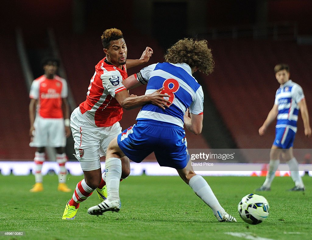 Serge Gnabry of Arsenal takes on Aaron Kuhl of Reading during the match between Arsenal U21 and Reading U21 in the Barclays Premier U21 League at Emirates Stadium on April 13, 2015 in London, England.