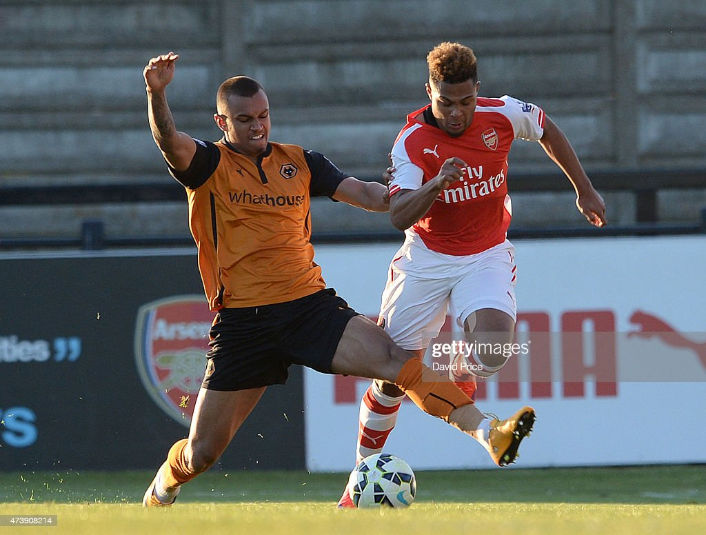 Serge Gnabry of Arsenal takes on Connor Hunte of Wolves during the match between Arsenal U21s and Wolverhampton Wanderers U21s at Meadow Park on May 18, 2015 in Borehamwood, England.