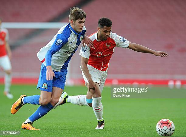 Serge Gnabry of Arsenal takes on Connor Mahoney of Blackburn during the match between Arsenal U21 and Blackburn Rovers U21 at Emirates Stadium on May...