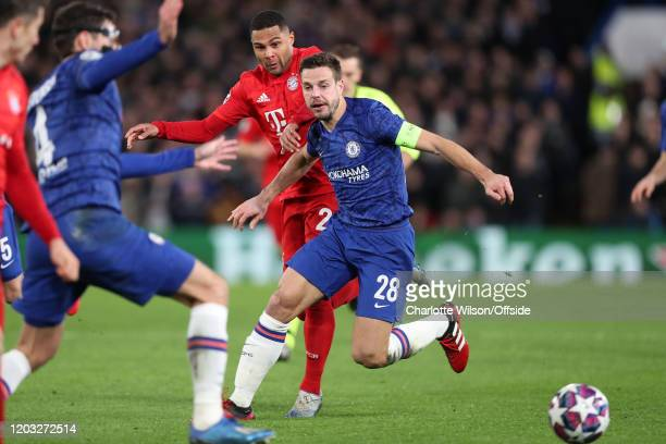 Serge Gnabry of Bayern and Cesar Azpilicueta of Chelsea during the UEFA Champions League round of 16 first leg match between Chelsea FC and FC Bayern...