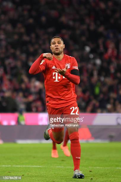 Serge Gnabry of Bayern Muenchen celebrates after scoring his team's first goal during the Bundesliga match between FC Bayern Muenchen and SC...