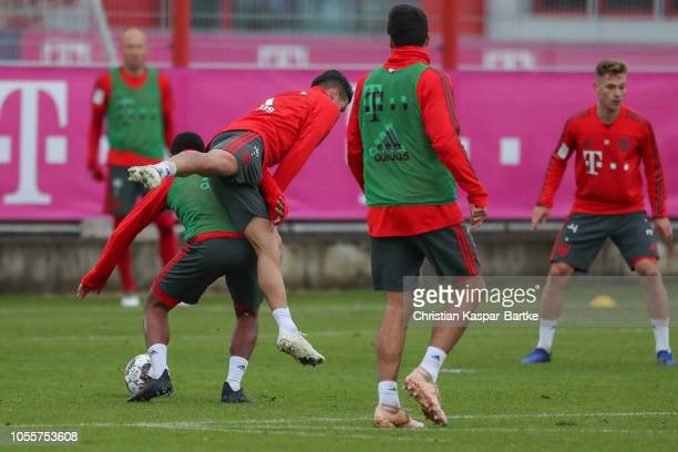 Serge Gnabry of Bayern Muenchen challenges James Rodriguez of Bayern Muenchen during a training session at Saebener Strasse training ground on...