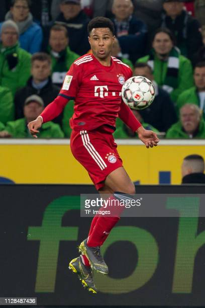 Serge Gnabry of Bayern Muenchen controls the ball during the Bundesliga match between Borussia Moenchengladbach and FC Bayern Muenchen at...