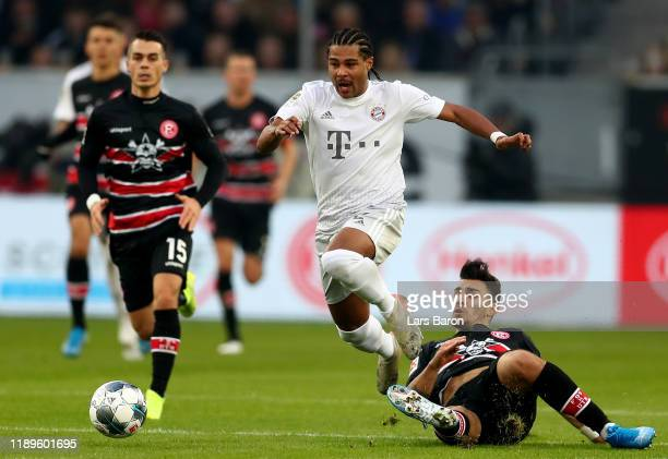 Serge Gnabry of Bayern Muenchen is challenged by Kaan Ayhan of Duesseldorf during the Bundesliga match between Fortuna Duesseldorf and FC Bayern...
