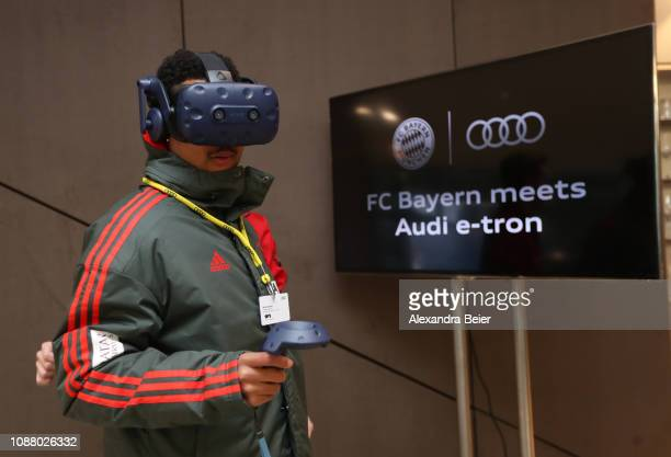 Serge Gnabry of Bayern Muenchen players a game with a virtual reality mask at Airport Munich on January 24 2019 in Munich Germany FC Bayern meets...