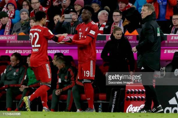 Serge Gnabry of Bayern Munchen, Alphonso Davies of Bayern Munchen during the German Bundesliga match between Bayern Munchen v Schalke 04 at the...