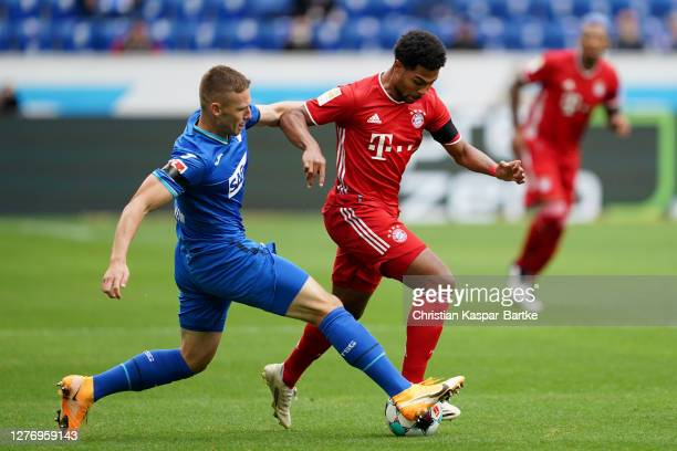 Serge Gnabry of Bayern Munich battles for possession with Pavel Kaderbek of TSG 1899 Hoffenheim during the Bundesliga match between TSG Hoffenheim...